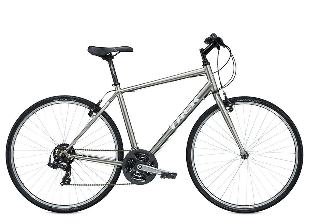 Велосипед TrekГородские<br>ВЕЛОСИПЕД TREK 7.0 FX (2015) – стильный туристический байк, который будет вашим верным спутником на любой дороге в самых сложных условиях. 21 скорость модели позволяют райдеру выбрать оптимальный вариант для конкретного дорожного участка. Стальная вилка гарантирует мягкую работу подвески, а ободные тормоза Tektro обеспечивают мощное и эффективное торможение. Ободья Bontrager AT-550 из алюминия отлично дополняют 28-дюймовые колеса. Шины Bontrager H2 гарантируют абсолютную цепкость и превосходный накат, что очень важно для горного байка.ВЕЛОСИПЕД 7.0 FX (2015) представлен в ассортименте нашего магазина. Байк реализуется по демократичной цене, отправляется в любой город России и имеет гарантию качества от производителя.<br><br>year: 2015<br>пол: мужской<br>уровень оборудования: любительский<br>длина хода вилки: нет<br>блокировка амортизатора: нет<br>планетарная втулка: нет<br>рулевая колонка: Регулируемый шарикоподшипник<br>вынос: Bontrager Approved, 25.4 мм, 25 градусов<br>руль: Bontrager Riser, сталь, подъем 30 мм<br>передний тормоз: Tektro, алюминиевый сплав<br>задний тормоз: Tektro, алюминиевый сплав<br>тормозные ручки: Shimano Altus<br>цепь: KMC Z51<br>система: Кованый сплава, 48/38/28 w/chainguard<br>педали: Wellgo, нейлоновая платформа<br>ободья: Bontrager AT-550, 36 отверстий, алюминиевый сплав<br>передняя втулка: Formula FM21, алюминиевый сплав<br>задняя втулка: Formula FM31, алюминиевый сплав<br>передняя покрышка: Bontrager H2, 700 x 35c<br>задняя покрышка: Bontrager H2, 700 x 35c<br>седло: Bontrager SSR<br>подседельный штырь: Bontrager SSR, 27.2 мм,  offset 12 мм<br>кассета: SunRace Freewheel 14-34, 7 скоростей<br>манетки: Shimano Altus EF51, 7 скоростей<br>рама: Алюминиевый сплав, FX Alpha Silver, совместим DuoTrap S, стойка и крепления брызговика<br>вилка: Высокопрочной стальной w/lowrider mounts, CLIX dropouts<br>цвет: серый<br>размер рамы: 22.5&amp;amp;quot;<br>материал рамы: алюминий<br>тип тормозов: ободной<br>диаметр колеса: