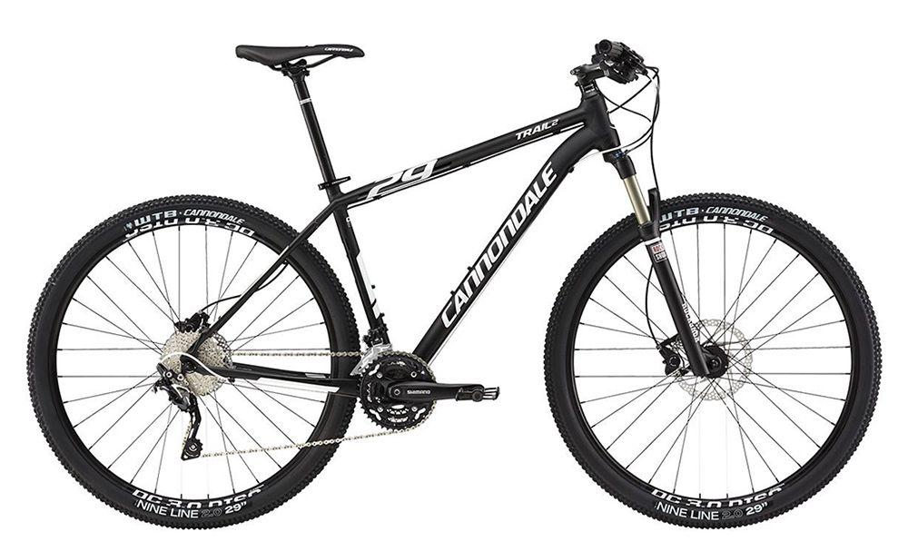 Велосипед CannondaleГорные<br>ВЕЛОСИПЕД CANNONDALE TRAIL 2 29 (2015) – этот велобайк прекрасно подходит для езды по городу и пересеченной местности, а также участия в любительских соревнованиях. Модель оснащена рамой, для изготовления которой производитель использовать современный алюминиевый сплав в сочетании с двойным баттингом. Это уникальная технология дает возможность регулировать толщину стенок трубок с одновременным укреплением самых «проблемных» участков. Также эта технология позволила значительно уменьшить вес велосипеда, что благоприятно отразилось на маневренности и удобстве управления.В нашем Интернет-магазине представлен широкий выбор велосипедов разного класса профессионализма. Мы предлагаем выгодно купить ВЕЛОСИПЕД CANNONDALE TRAIL 2 29 (2015) в Москве. Осуществляем доставку по всей России.<br><br>year: 2015<br>пол: мужской<br>тип рамы: хардтейл<br>уровень оборудования: профессиональный<br>длина хода вилки: от 100 до 150 мм<br>блокировка амортизатора: да<br>рулевая колонка: Tange Zstep<br>вынос: Cannondale C3, 1-1/8<br>руль: Cannondale C3, алюминиевый сплав 6061, ширина 700 мм, подъем 20 мм<br>грипсы: Cannondale Locking Grips<br>передний тормоз: Shimano M506, диаметр ротора 180 мм<br>задний тормоз: Shimano M506, диаметр ротора 160 мм<br>тормозные ручки: Shimano M506<br>цепь: KMC X10, 10 скоростей<br>система: Shimano M522, Octalink, 42/32/24<br>каретка: Shimano BB-ES25<br>педали: Cannondale Platform<br>ободья: Alex DC 3.0, с двойной стенкой, 32 отверстия<br>передняя втулка: Formula CDH20<br>задняя втулка: Formula CDH22<br>спицы: 15g нержавеющая сталь, черные<br>передняя покрышка: WTB NineLine, 29<br>задняя покрышка: WTB NineLine, 29<br>седло: Cannondale Stage 3<br>подседельный штырь: Cannondale C4, алюминиевый сплав 6061, 27.2 мм<br>кассета: SunRace, 11-36, 10 скоростей<br>манетки: Shimano Deore<br>рама: Алюминиевый сплав 6061, Trail, save, головная труба 1-1/8<br>вилка: RockShox 30 Gold TK 29, 100 мм, Solo Air, дистанционная блокировка, rebound, taper